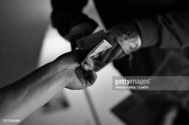 close-up of hand holding money - corruption stock pictures, royalty-free photos & images