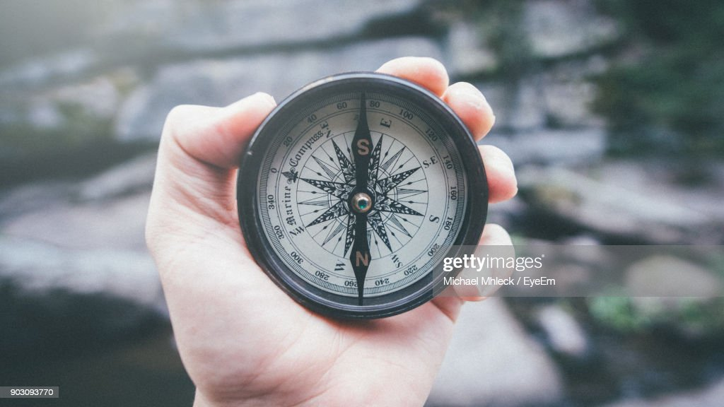 Close-Up Of Hand Holding Navigational Compass : Stock Photo