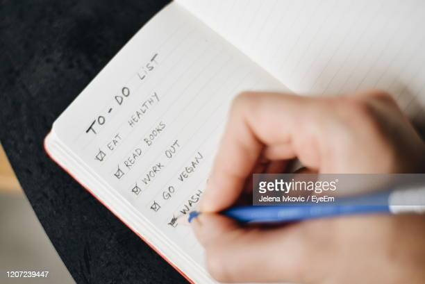 close-up of hand holding paper with text - to do list stock pictures, royalty-free photos & images