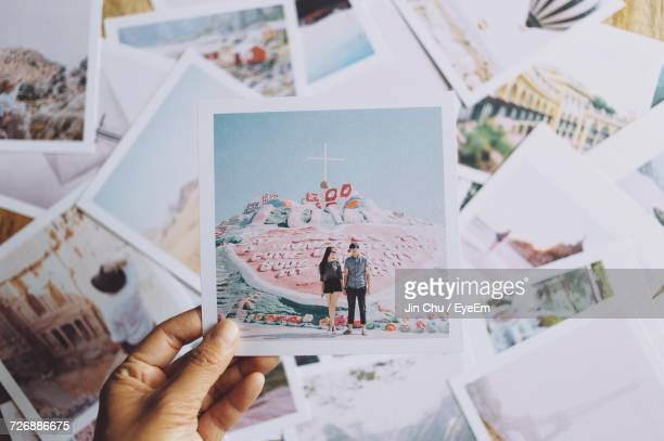 close-up of hand holding photograph of couple - photography stock pictures, royalty-free photos & images