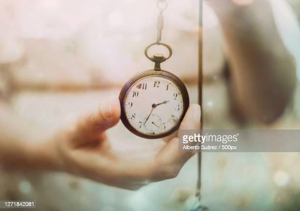 close-up of hand holding pocket watch, las palmas de gran canaria, spain - 人体部位 ストックフォトと画像