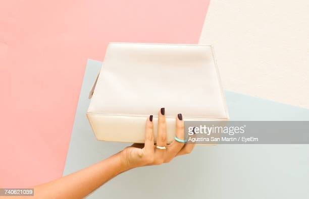 close-up of hand holding purse - clutch bag stock pictures, royalty-free photos & images