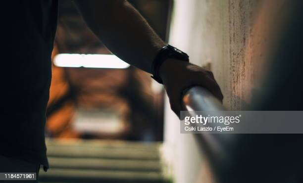 close-up of hand holding railing - railing stock pictures, royalty-free photos & images