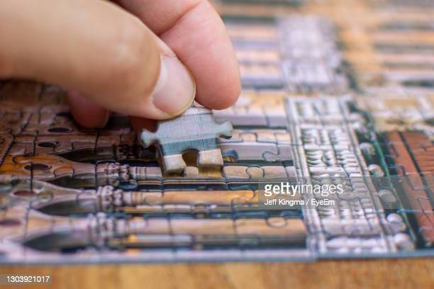 close-up of hand holding table - finishing stock pictures, royalty-free photos & images