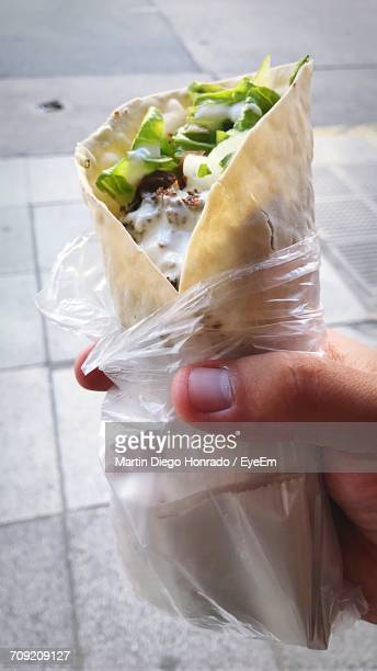 Close-Up Of Hand Holding Tortilla