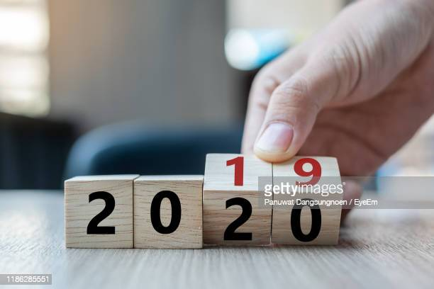close-up of hand holding toy blocks on table - 2019 stock pictures, royalty-free photos & images