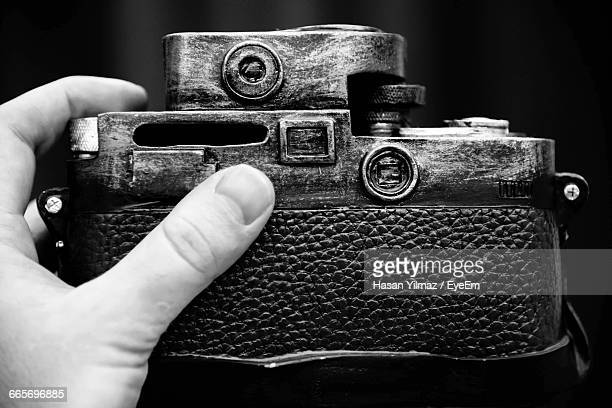 Close-Up Of Hand Holding Vintage Camera
