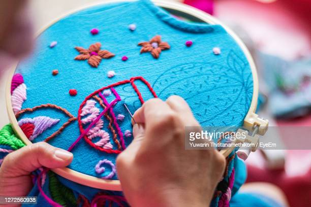 close-up of hand making embroidery - embroidery stock pictures, royalty-free photos & images