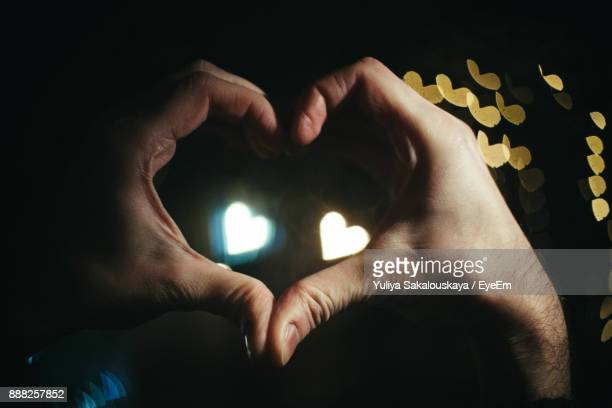 Close-Up Of Hand Making Heart Shape