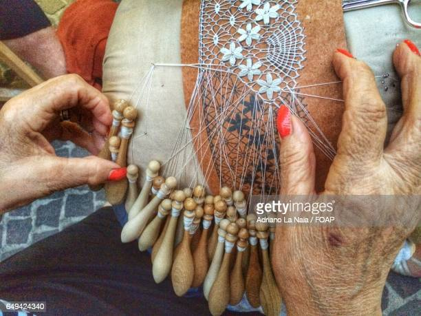 close-up of hand making lace - lacemaking stock pictures, royalty-free photos & images