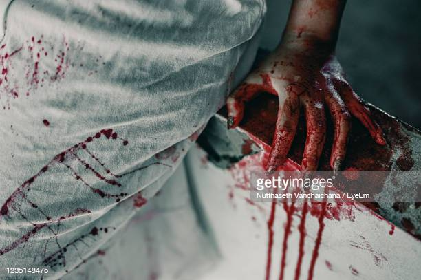 close-up of hand on red floor - murder stock pictures, royalty-free photos & images