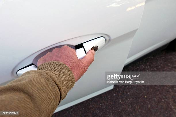 Close-Up Of Hand Opening Car Door