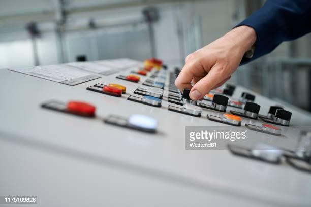 close-up of hand operating control panel - steuerpult stock-fotos und bilder