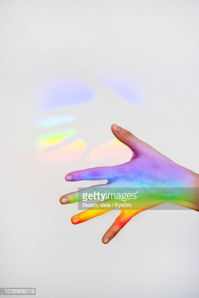 close-up of hand over white background - bisexuality stock pictures, royalty-free photos & images