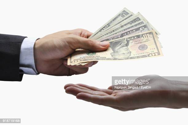 close-up of hand paper currency over white background - male likeness stock pictures, royalty-free photos & images