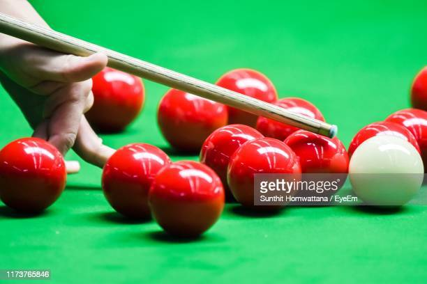 close-up of hand playing snooker - snooker stock pictures, royalty-free photos & images