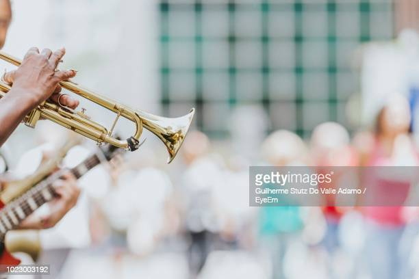 Close-Up Of Hand Playing Trumpet
