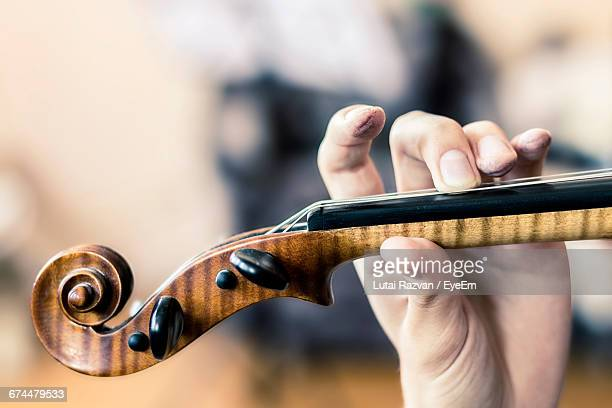 close-up of hand playing violin - lutai razvan stock pictures, royalty-free photos & images