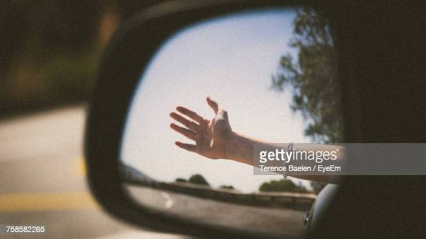 Close-Up Of Hand Reflected In Mirror