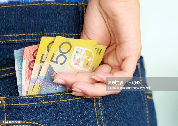 close-up of hand removing paper currencies from pocket - banknote stock pictures, royalty-free photos & images