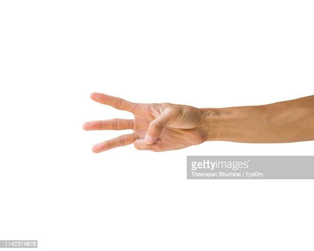 close-up of hand showing number 3 against white background - getal 3 stockfoto's en -beelden