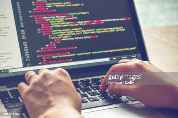 close-up of hand using laptop - coding stock pictures, royalty-free photos & images