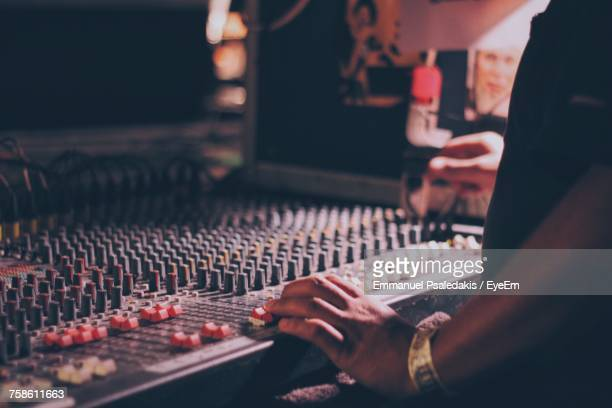 close-up of hand using sound mixer - sound recording equipment stock pictures, royalty-free photos & images
