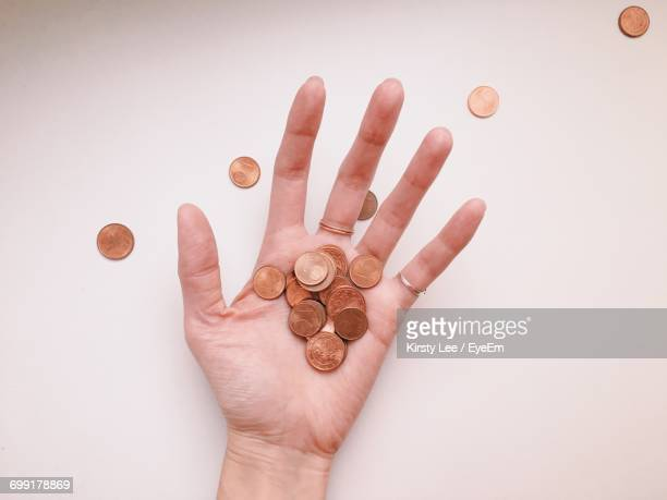 Close-Up Of Hand With Coins
