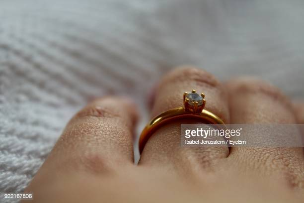 close-up of hand with diamond ring - skin diamond stock pictures, royalty-free photos & images