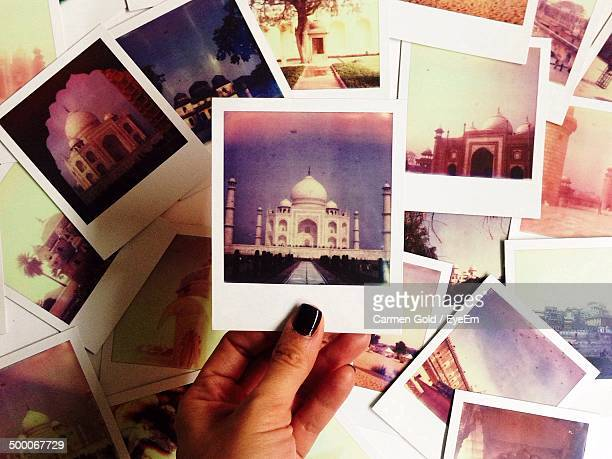 Close-up of hand with pictures of Taj Mahal