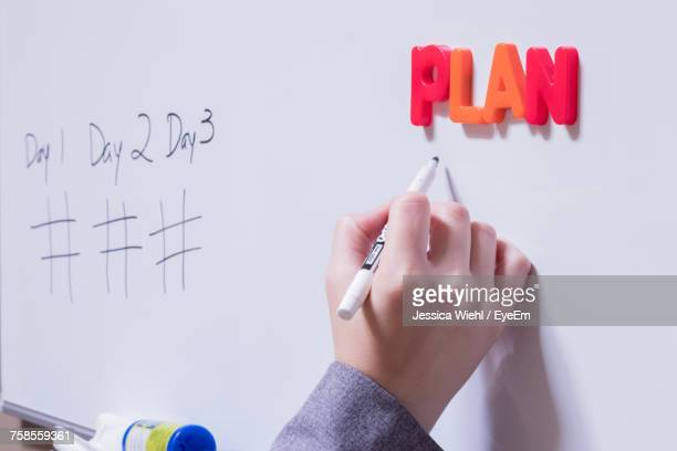 close-up of hand writing on whiteboard - business plan stock pictures, royalty-free photos & images