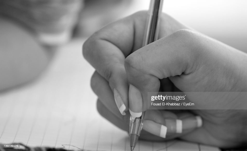 Close-Up Of Hand Writing : Stock Photo