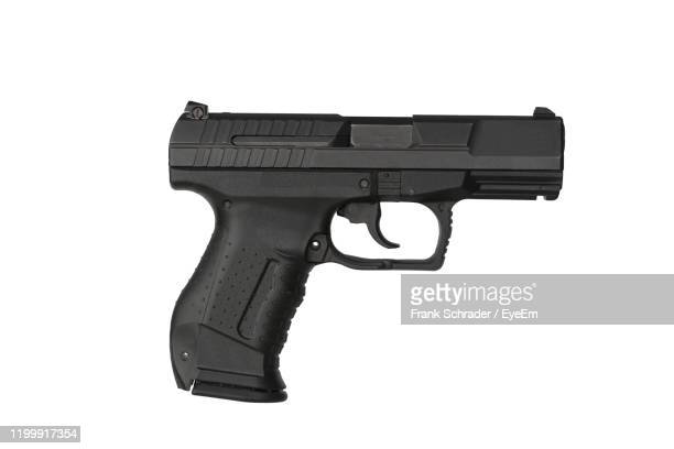 close-up of handgun against white background - frank schrader stock pictures, royalty-free photos & images