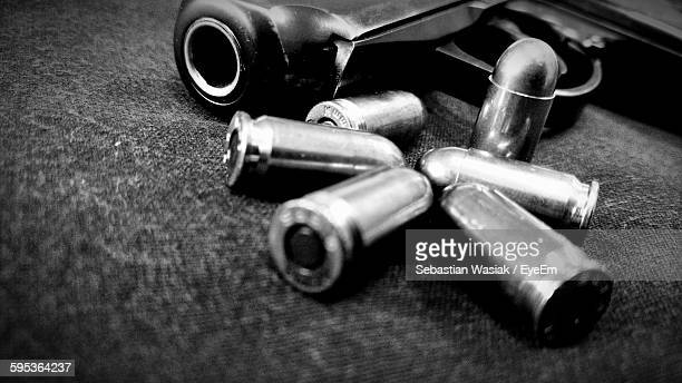 close-up of handgun and bullets - weapon stock pictures, royalty-free photos & images