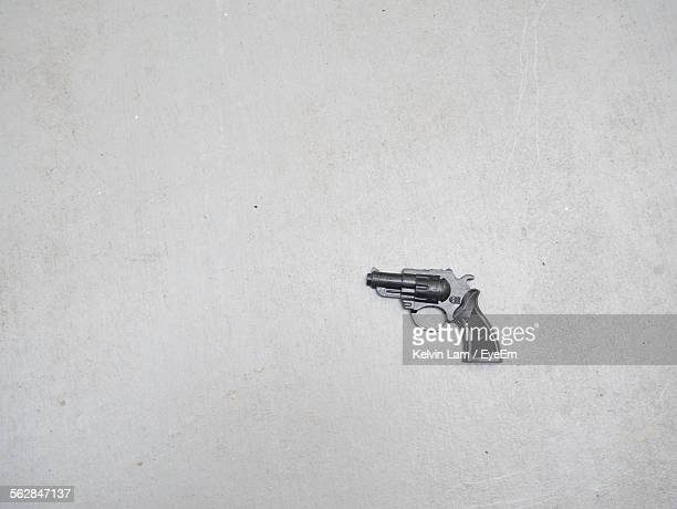 Close-Up Of Handgun With White Background