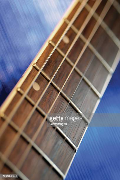 close-up of handle and strings of electric guitar - modern rock stock pictures, royalty-free photos & images