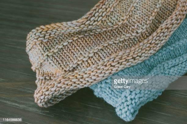 close-up of handmade knitwear on dresser - ウール ストックフォトと画像