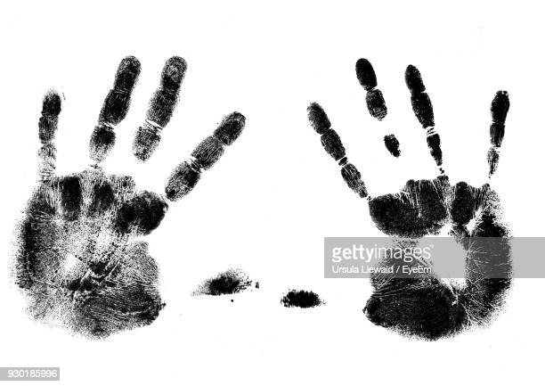 Close-Up Of Handprints On White Background
