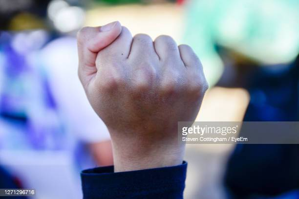 close-up of hands against blurred background - steven cottingham stock-fotos und bilder