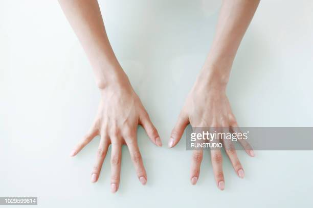 close-up of hands against white background - body massage japan stock pictures, royalty-free photos & images