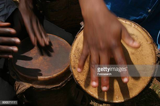 Close-up of hands beating drums