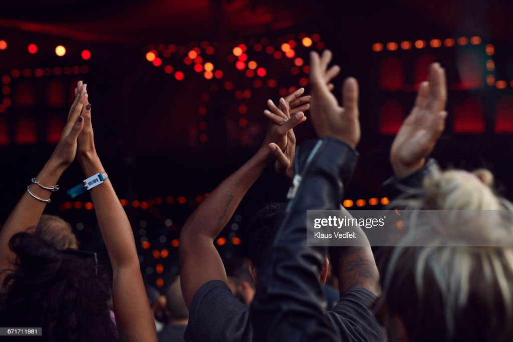 Close-up of hands clapping at concert : Stock Photo
