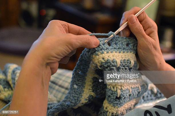 Close-Up Of Hands Crocheting At Home