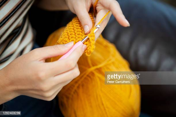 close-up of hands doing crochet - crochet stock pictures, royalty-free photos & images