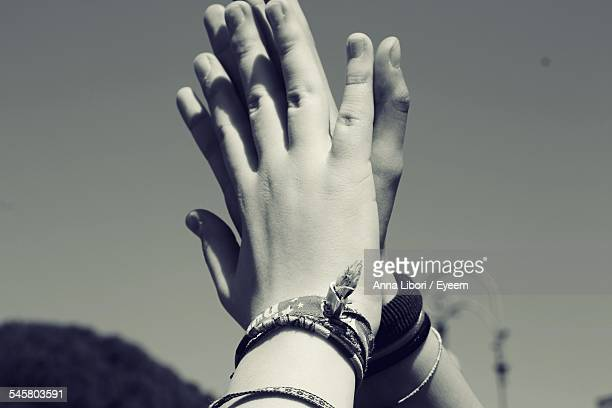 Close-Up Of Hands Doing High-Five