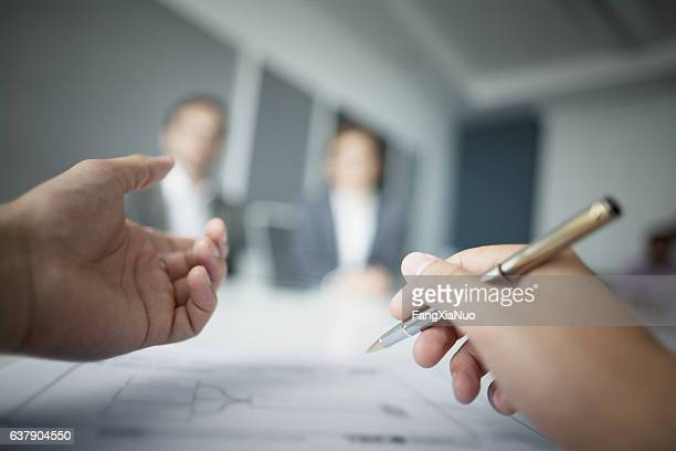 close-up of hands gesturing during business meeting in office - employment law stock photos and pictures