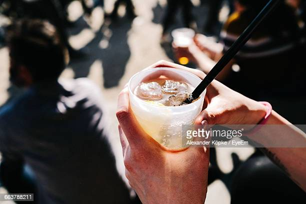 Close-Up Of Hands Holding A Drink