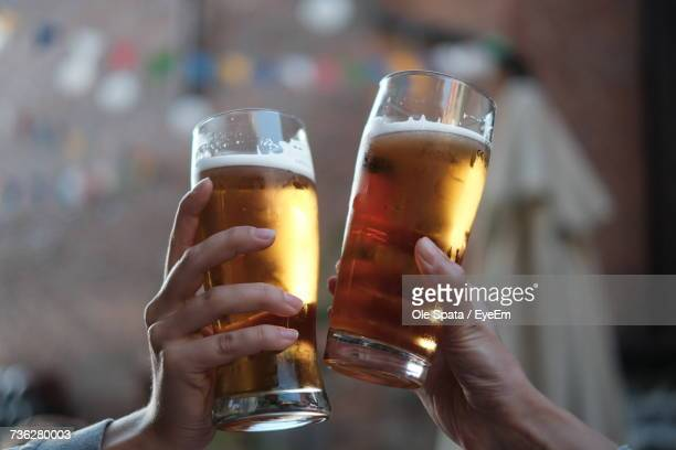 close-up of hands holding beer glasses - honour stock pictures, royalty-free photos & images