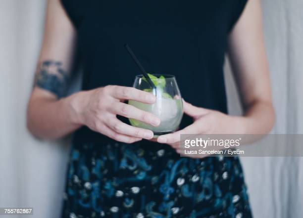 Close-Up Of Hands Holding Drink