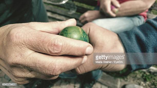 close-up of hands holding easter egg - italian easter stock pictures, royalty-free photos & images